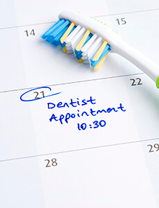 Toothbrush on calendar with Dentist Appointment note